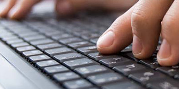 hands-typing-on-a-laptop-keyboard