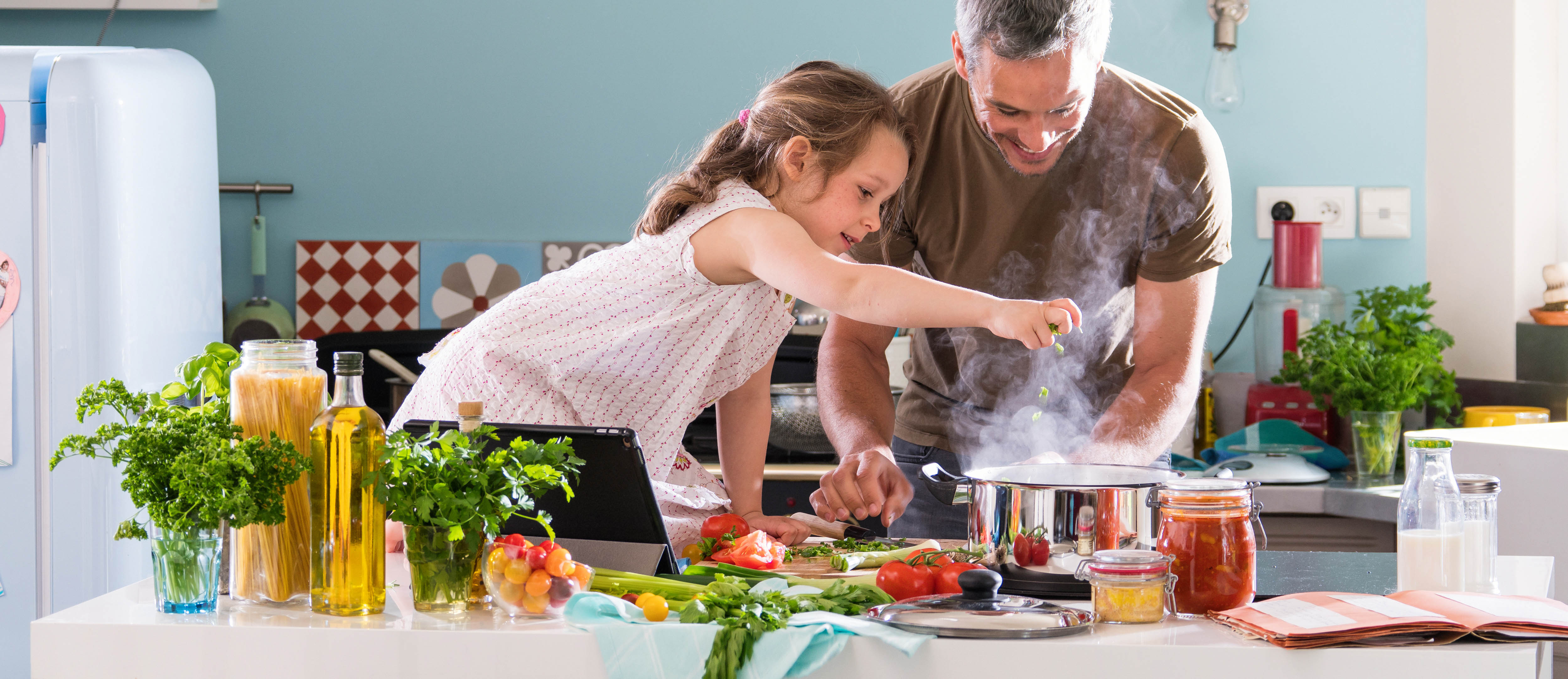 Father and daughter following a recipe