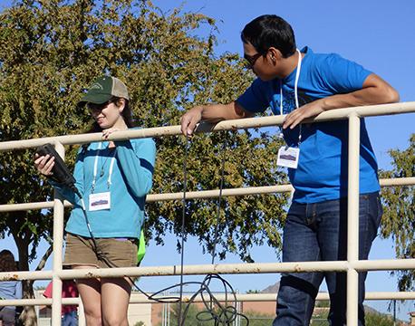 student teachers doing research on bridge