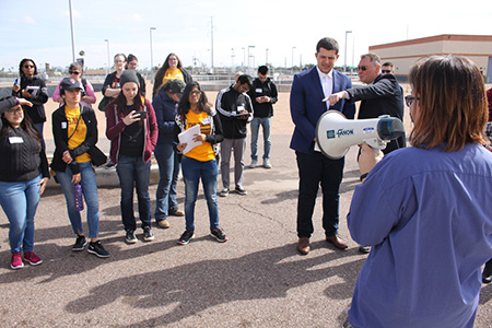 Students taking tour of above-ground storage tank facility