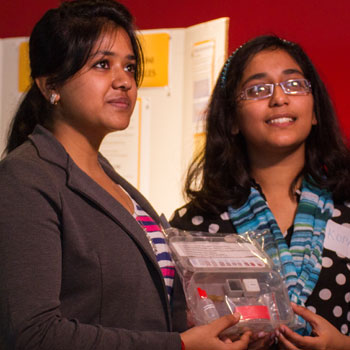 2014 Intel ISEF winners at presenting their research at the Arizona Science Center
