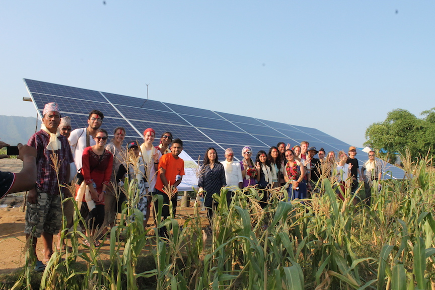 Picture of ASU Students standing in front of Soalr panels in Nepal