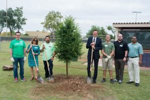Urban Forestry members around newly planted tree