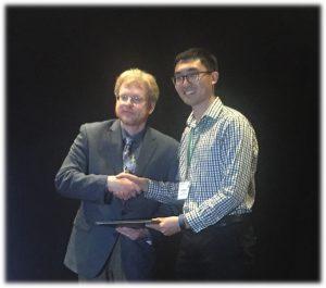 Qunshan Zhao recieving award