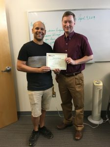 UCRC Director, Dr. David Sailor presenting Lance Watkins his 1st place, Graduate Category, for the 2019 UCRC Poster Competition
